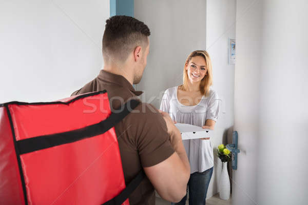 Pizza Delivery Man With Large Red Bag Stock photo © AndreyPopov