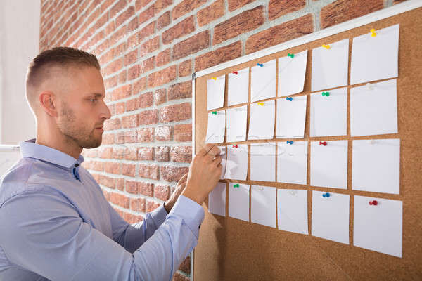 Stock photo: Businessman Looking At Notes