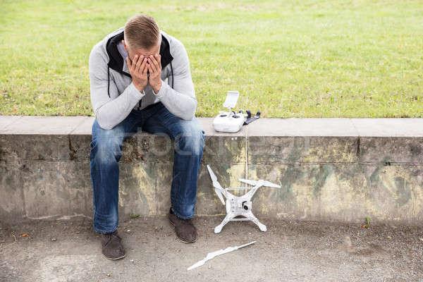 Worried Man With Broken Drone Stock photo © AndreyPopov