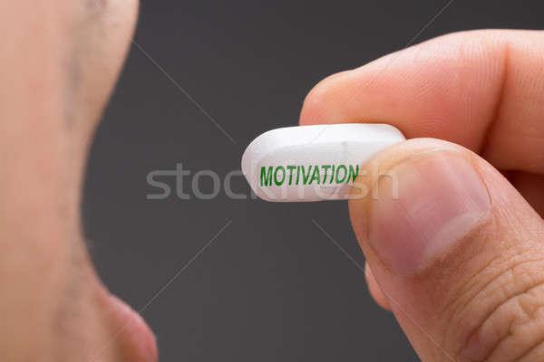 Hombre motivación píldora gris imagen salud Foto stock © AndreyPopov