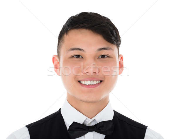 Foto stock: Retrato · jóvenes · camarero · sonriendo · pie · blanco