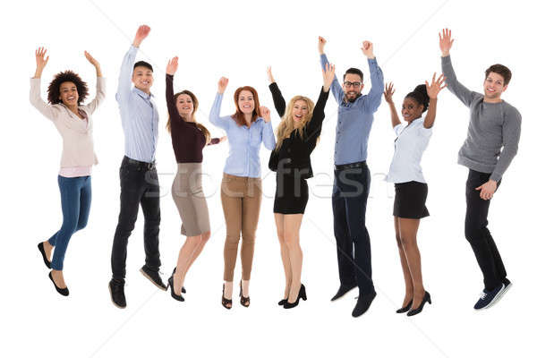 Portrait Of Excited College Students Raising Their Arms Stock photo © AndreyPopov