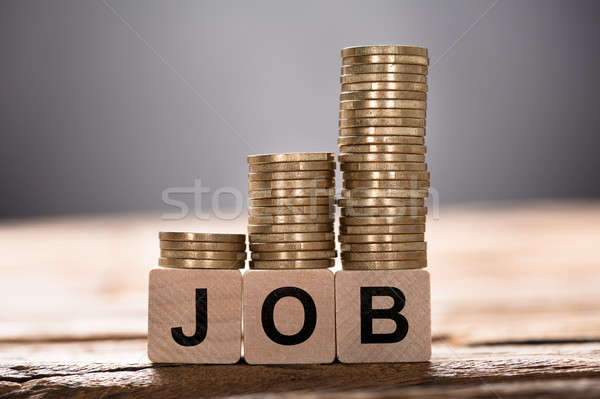 Job Text Written On Wooden Blocks With Stacked Coins Stock photo © AndreyPopov