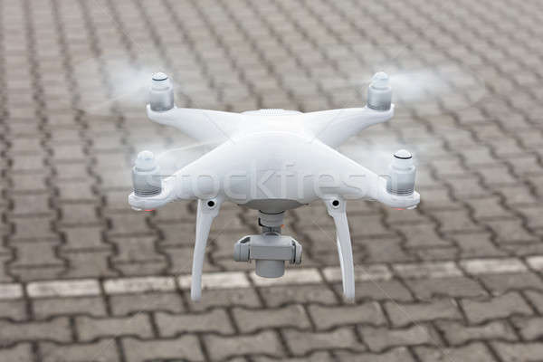 Drone flying over cobbled street Stock photo © AndreyPopov