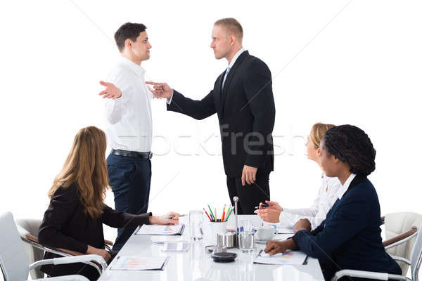 Boss Blaming Male Executive In Meeting Stock photo © AndreyPopov