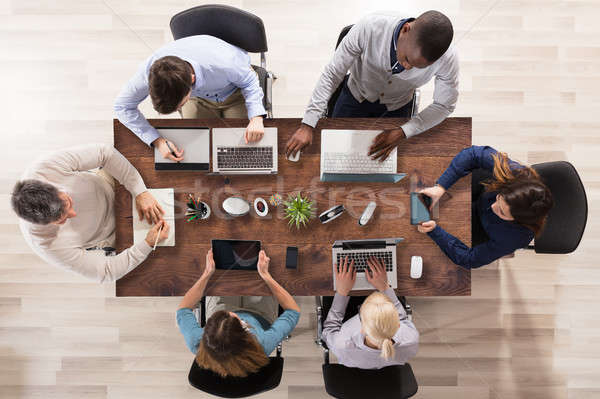 Stock photo: Elevated View Of Businesspeople Working In Office