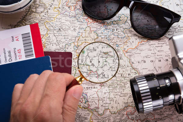 Human Hand Looking At Map With Magnifying Glass Stock photo © AndreyPopov