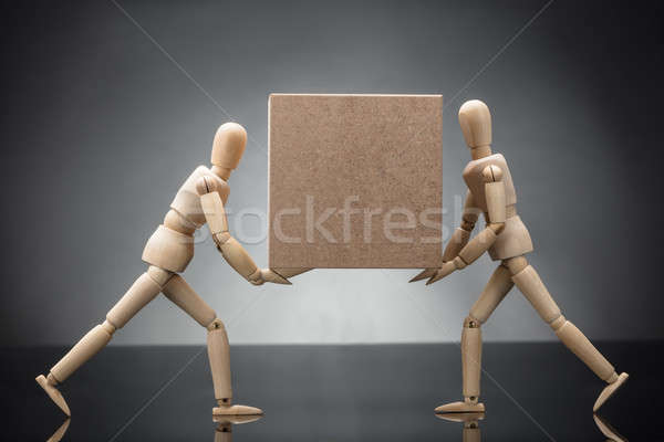 Wooden Dummy Couple Carrying Cardboard Box Stock photo © AndreyPopov