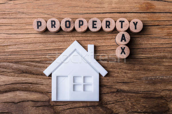 House Model Near Blocks With Property And Tax Text Stock photo © AndreyPopov