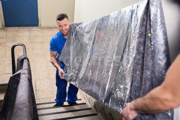 Kettő hordoz bútor lépcsőház fiatal férfi Stock fotó © AndreyPopov