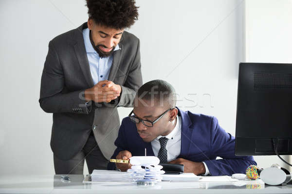 Worried Man Looking At Auditor Analyzing Bill Stock photo © AndreyPopov