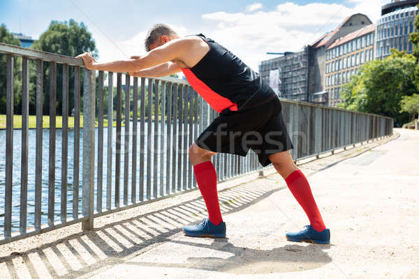 Man Doing Push-Ups On Railing Stock photo © AndreyPopov