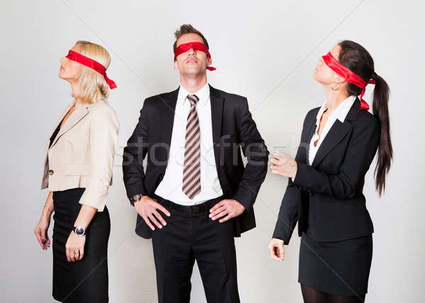 Group of disoriented businesspeople Stock photo © AndreyPopov