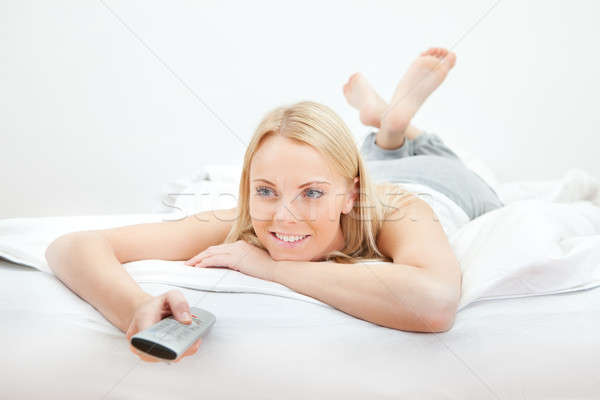 Young beautiful woman lying in bed Stock photo © AndreyPopov