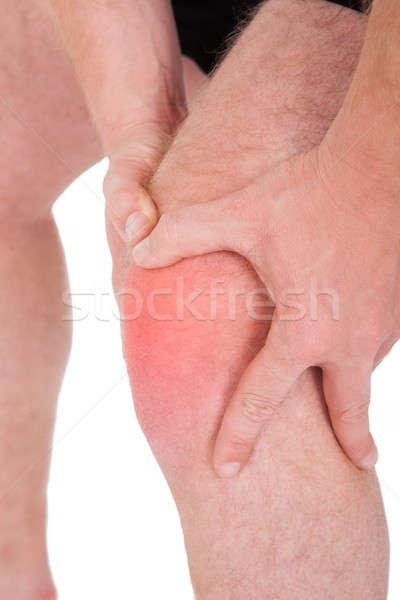 Homem joelho dor branco esportes saúde Foto stock © AndreyPopov