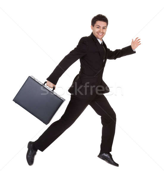 Businessman running with his briefcase Stock photo © AndreyPopov