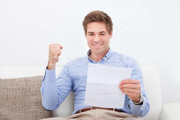 Man Holding Paper Stock photo © AndreyPopov