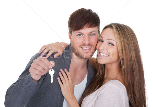 Big key held by boyfriend Stock photo © AndreyPopov