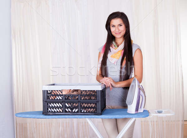 Cheerful housewife doing the ironing Stock photo © AndreyPopov