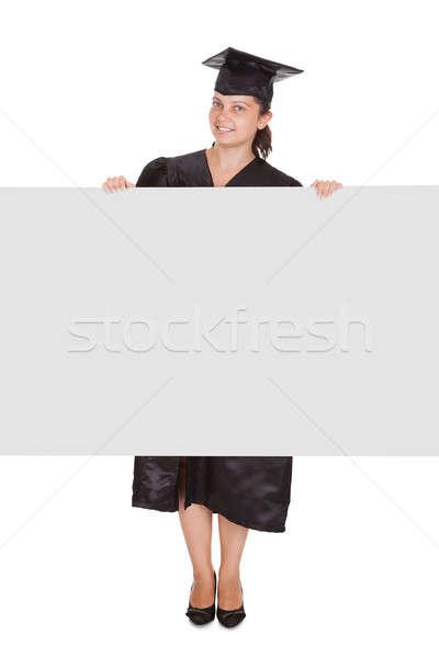 Graduate woman holding blank placard Stock photo © AndreyPopov