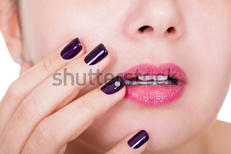 Young Woman With Pink Nail Varnish Stock photo © AndreyPopov