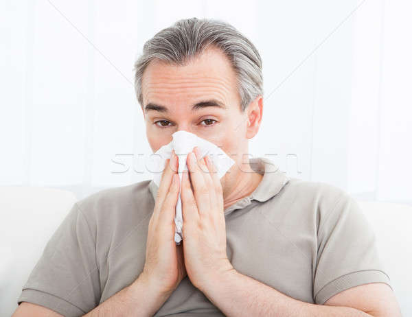 Man blowing his nose Stock photo © AndreyPopov