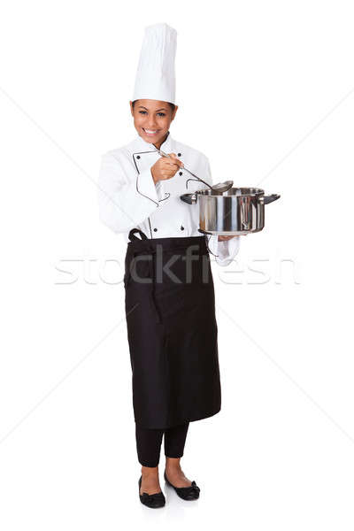 Female Chef With Cooking Pot In Hand Stock photo © AndreyPopov
