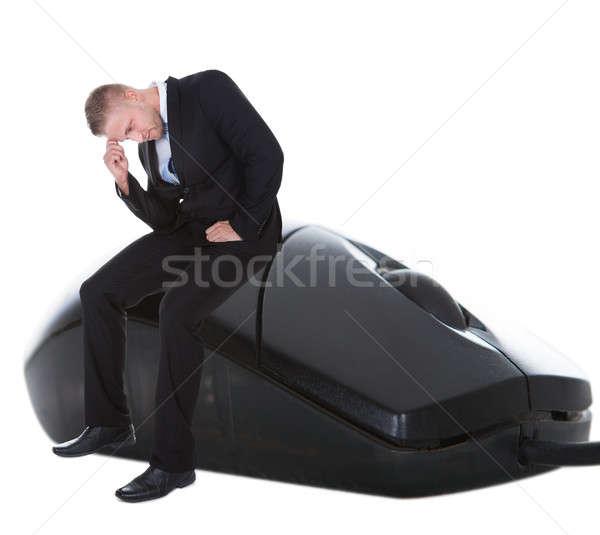Preocupado empresario sesión ratón de la computadora cabeza mano Foto stock © AndreyPopov