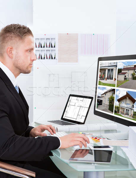 бизнесмен собственности портфеля онлайн агент по продаже недвижимости сидят Сток-фото © AndreyPopov