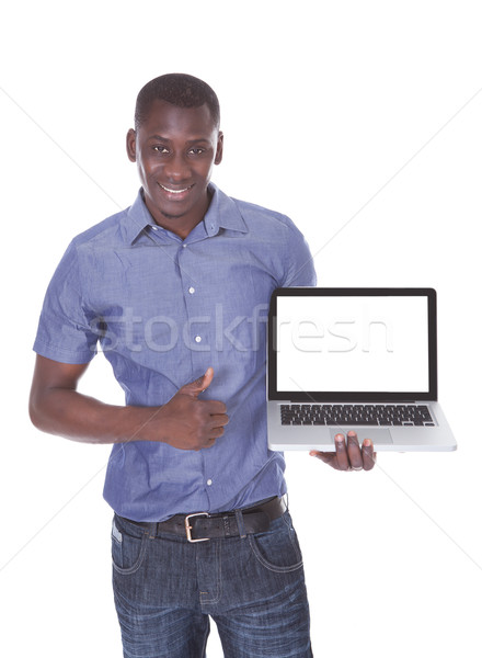 Man Pointing Towards Laptop Stock photo © AndreyPopov