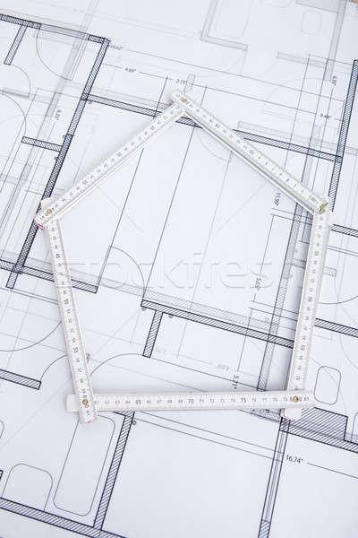 Folding Ruler In House Shape On Blueprint Stock photo © AndreyPopov