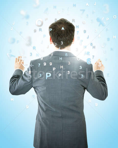 Businessman With Alphabets And Numbers Stock photo © AndreyPopov