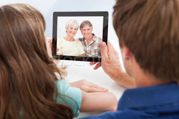 Daughter With Father Video Chatting On Digital Tablet Stock photo © AndreyPopov