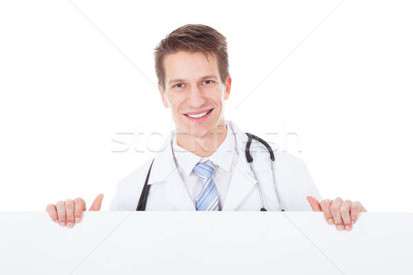 Stock photo: Male Doctor Holding Placard