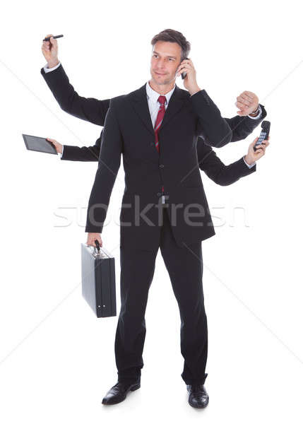 Multitasking Businessman Stock photo © AndreyPopov