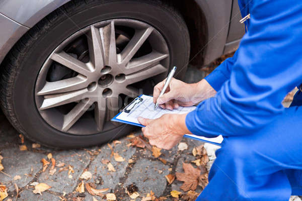 Worker Maintaining Car Records Stock photo © AndreyPopov