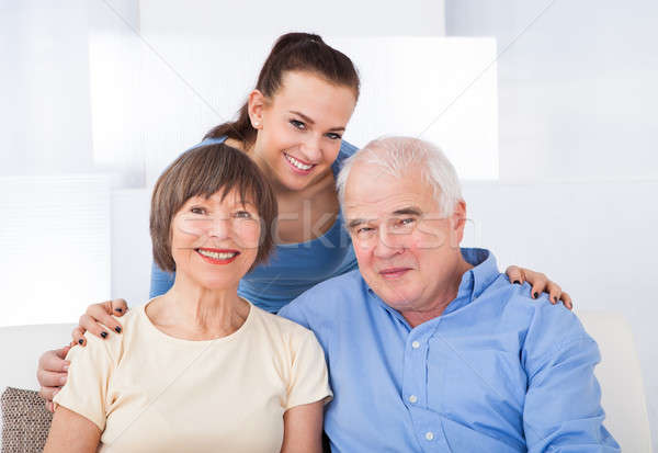 Happy Caregiver With Senior Couple Stock photo © AndreyPopov