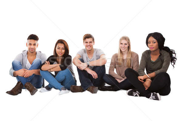 Multiethnic College Students Sitting In A Row Stock photo © AndreyPopov