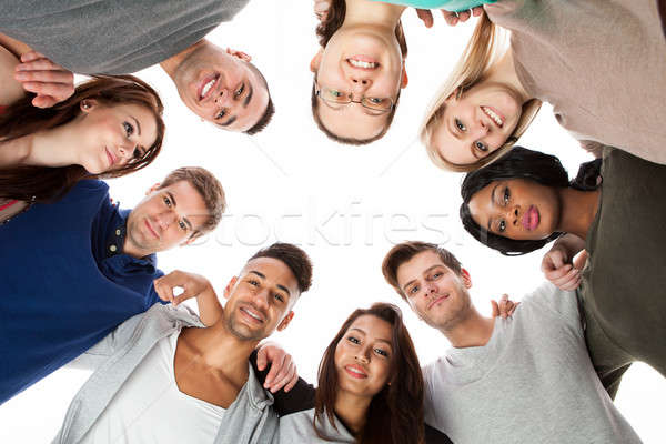 Confident College Students Forming Huddle Stock photo © AndreyPopov