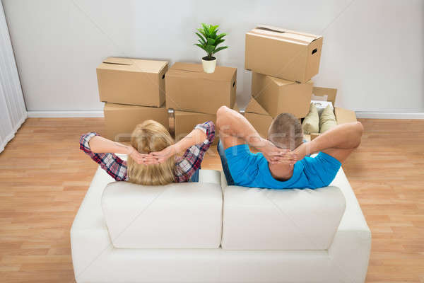 Young Couple Relaxing On Couch Stock photo © AndreyPopov