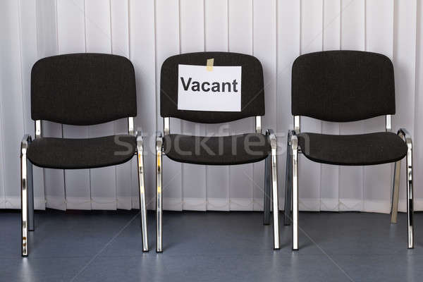 Stock photo: Office Chair With A Vacant Sign