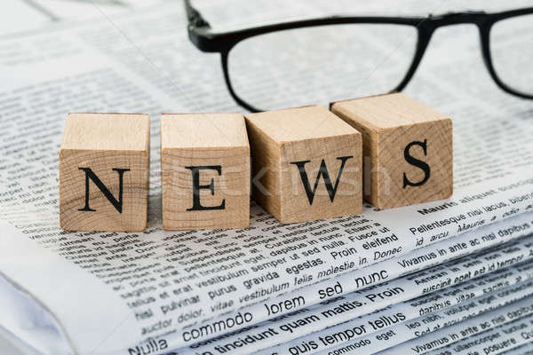 News Text On Wooden Blocks With Eyeglasses Stock photo © AndreyPopov