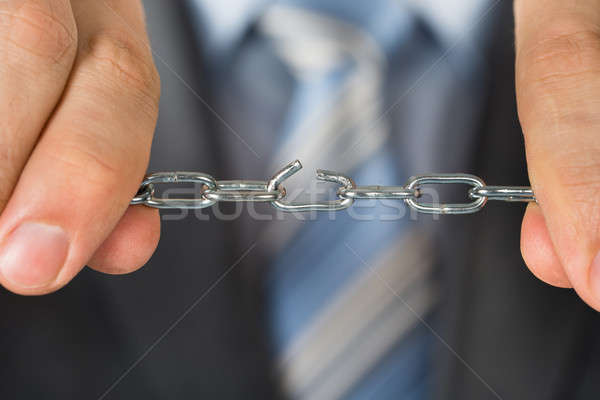 Close-up Of Man Holding Broken Chain Stock photo © AndreyPopov