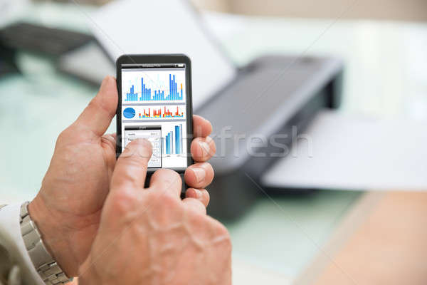 Person Using Cellphone For Printing Stock photo © AndreyPopov