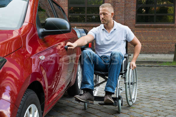 Handicapped Man Opening Door Of A Car Stock photo © AndreyPopov