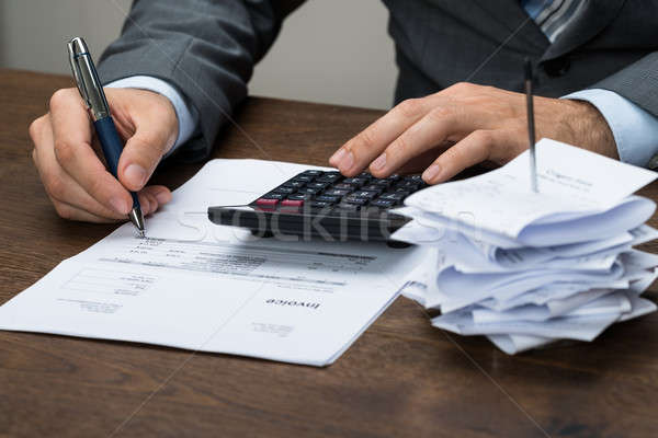 Businessperson Calculating Financial Expenses Stock photo © AndreyPopov