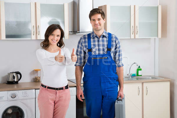 Woman With Repairman Showing Thumbs Up Sign Stock photo © AndreyPopov