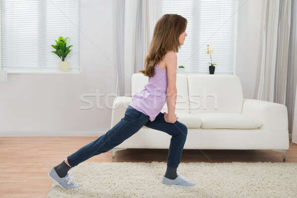 Girl Exercising In Living Room Stock photo © AndreyPopov