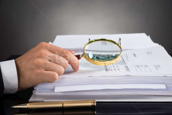 Businessperson Hands Analyzing Receipt With Magnifying Glass Stock photo © AndreyPopov