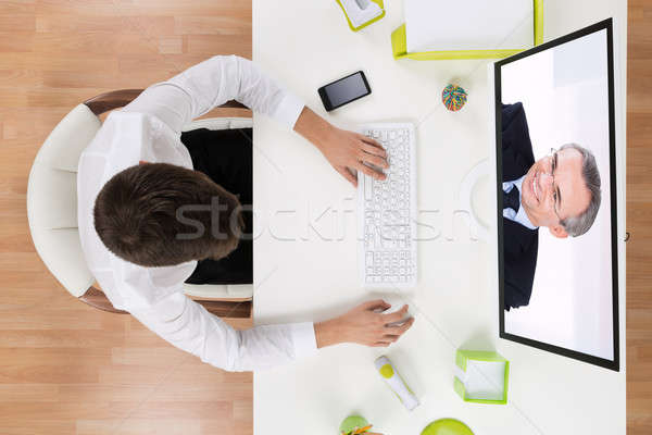 Businessman Videochatting With Senior Staff Stock photo © AndreyPopov